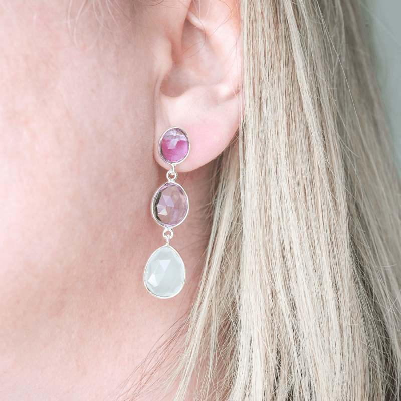 long stone drop earrings on lobe