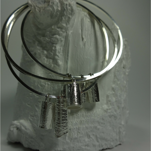 contemporary sterling silver bracelet with a choice of abstract charms