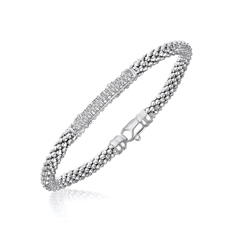 Sterling Silver Rhodium Finished Diamond Accented Popcorn Bangle (.14cttw)