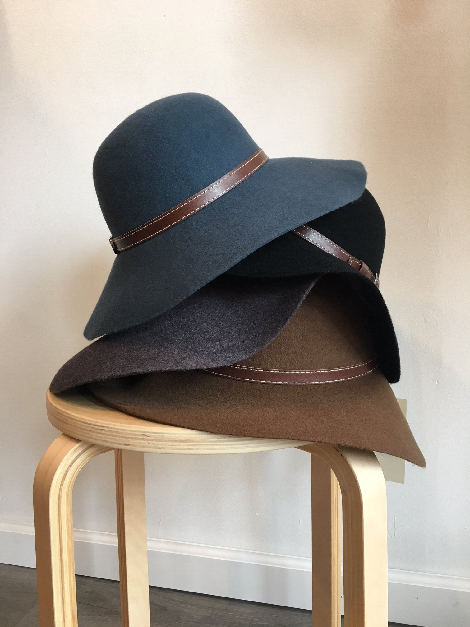 Kingston Wool Wide Brim Hat - stack of floppy wool hats
