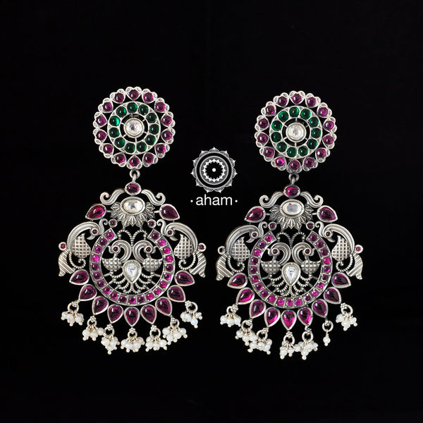 Large, 92.5 Sterling silver peacock earrings with pink and green spinel stone setting.  Make heads turn with these gorgeous pair of handcrafted earrings.