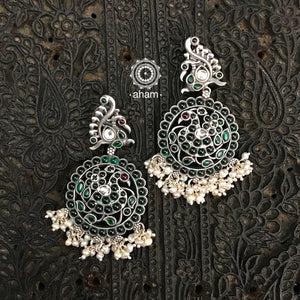 Stunning and gorgeous, an impeccably handcrafted pair of green stone earring in 92.5 Sterling Silver, with hanging pearls.