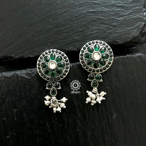 Stunning and gorgeous, an impeccably handcrafted pair of Green stone earrings in 92.5% Sterling Silver.