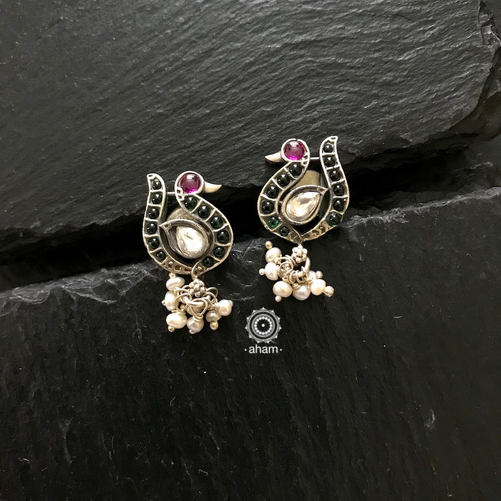Stunning and gorgeous, an impeccably handcrafted peacock studs in 92.5% Sterling Silver, with hanging pearls.