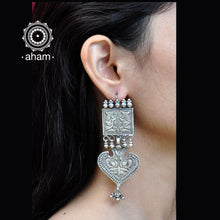 Handcrafted silver earring from Rajasthan. Classic Peacock Motif carving in this two layer earring.  Hook fastening which is easy to wear.
