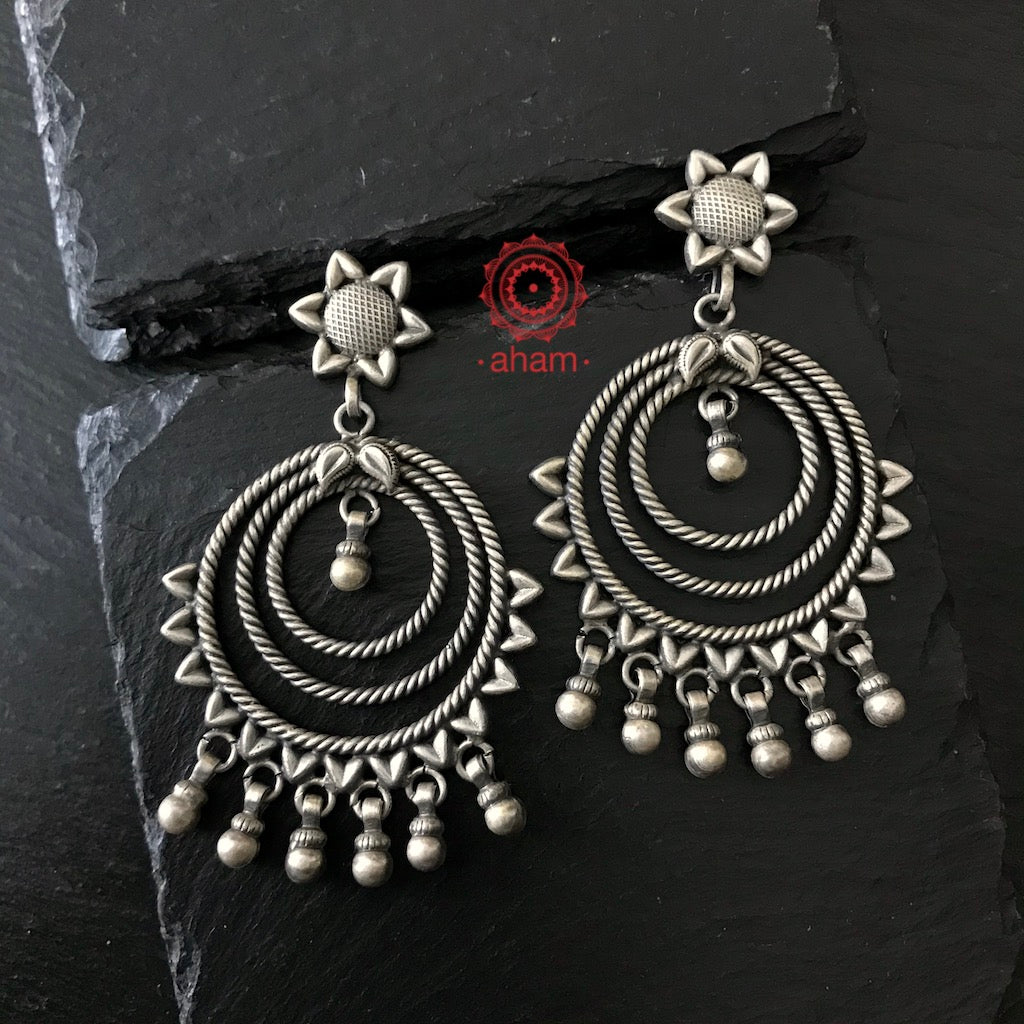 Our Mewad collection is a tribute to the rich cultural heritage of Rajasthan. Handcrafted  in 92.5 by skilled craftsman,  this simple and elegant earring has a sunflower stud fastening and three concentric circles with hanging ghunghroos. A must have earring in your collection. The Indian Garba Season/Navratri Festival is a perfect occasion to buy this earring.