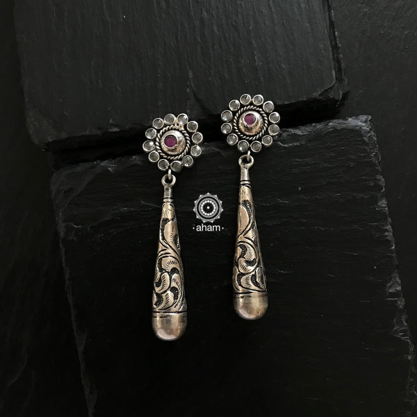 92.5 Silver Mewad earring. An ode to the glorious heritage of Rajasthan.  Beautifully carved Chitai work earrings with kemp flower zircon top.