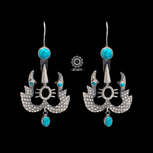 92.5 Sterling Silver earrings with turquoise stone setting.