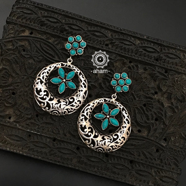 92.5 Sterling Silver Earrings with turquoise coloured stones.