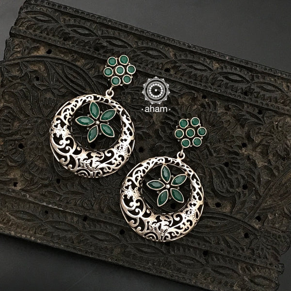 92.5 Sterling Silver Earrings with green coloured stones.