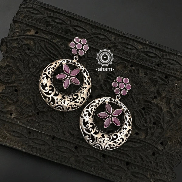 92.5 Sterling Silver Earrings with maroon coloured stones.