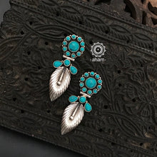 92.5 Sterling Silver Earrings with turquoise coloured stones. Light weight and easy to wear.