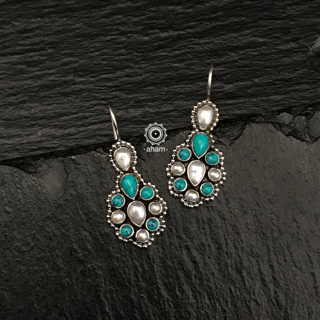 Silver Earrings with Turquoise & Pearl.  Light weight and great for everyday wear. The grid image depicts the other colours in this design and model image for size reference.