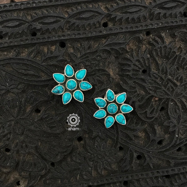 Silver Earrings with Turquoise stones. Light weight and great for everyday wear. The grid image depicts the other colours in this design and model image for size reference