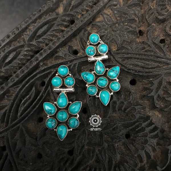 Silver Earrings with Turquoise stones. Light weight and great for everyday wear. The grid image depicts the other colours in this design and model image for size reference.
