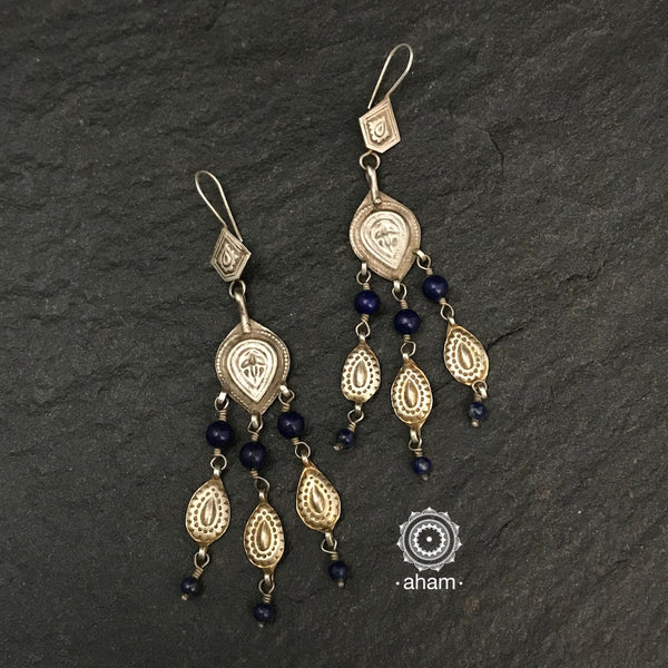 The earrings are sourced from the Turkmen central Asia regions.  The dents, the marks, the irregularities all add to the charm and tell a story of where they comes from.
