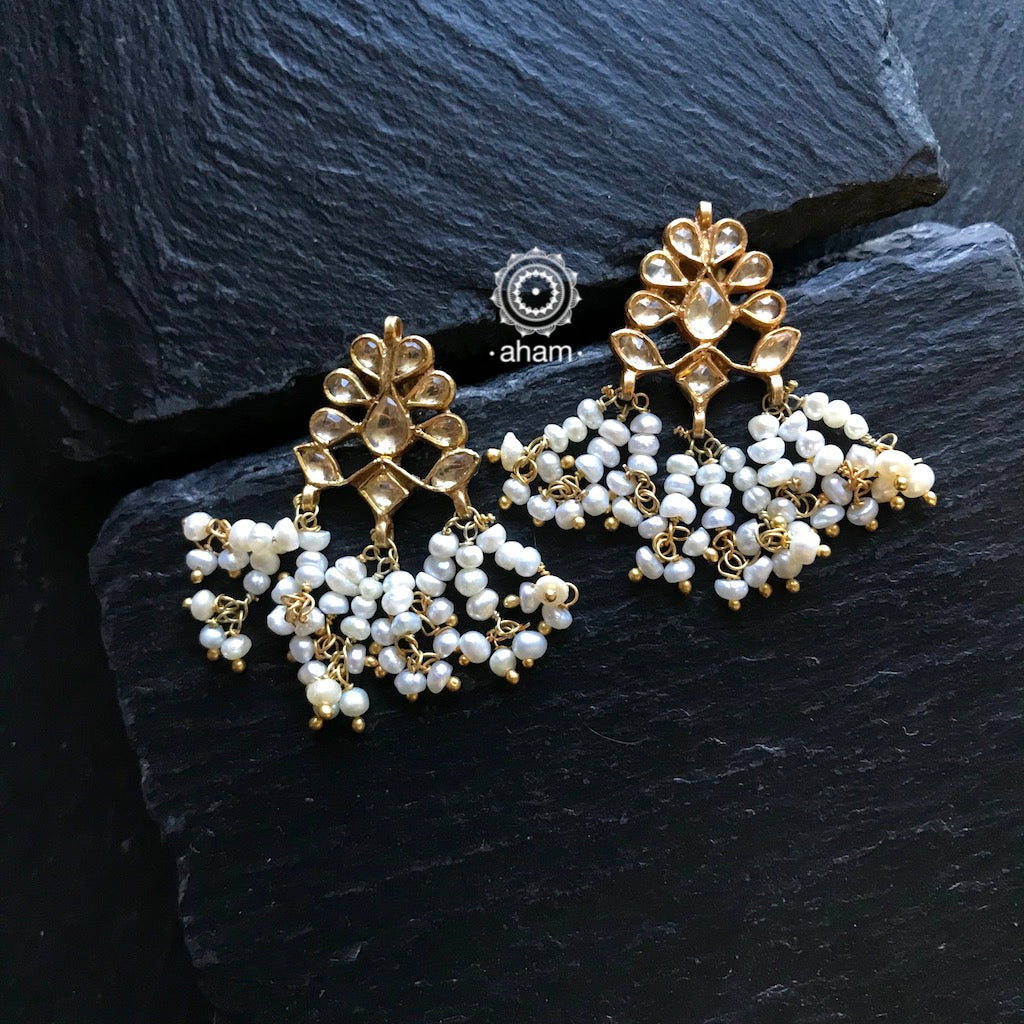 Gold polish earring in 92.5 Sterling silver, with semi precious stones and hanging pearls.