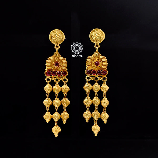 Catch everyone's attention with this beautiful Sterling Silver (92.5%) uniquely designed earring. Crafted using ancient South Indian antique gold temple jewellery technique,  the entire piece is made in pure silver and dipped in gold.
