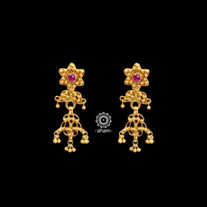 Catch everyone's attention with this beautiful Silver (80%) uniquely designed earring. Crafted using ancient South Indian antique gold temple jewellery technique, the entire piece is made in pure silver and dipped in gold.