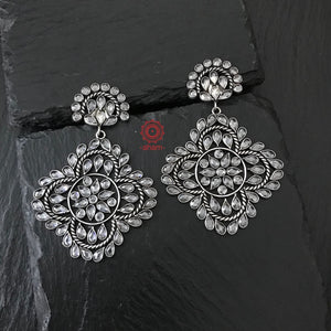 Shine like a star in these Contemporary flower pattern Zircon earrings. Pair it with your black dress to take it up a notch! Handcrafted to perfection in 92.5 Sterling Silver.