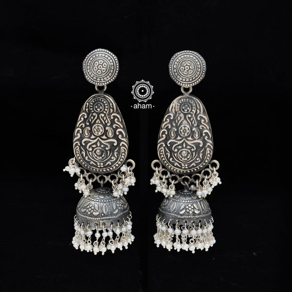 Make heads turn wherever you go with this pair of beautiful Jhumkies handcrafted  in Sterling Silver (92.5) with pea