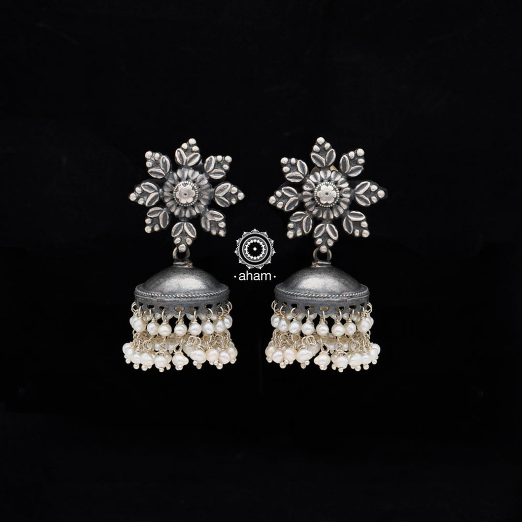 Make heads turn wherever you go with this pair of beautiful Jhumkies handcrafted  in Sterling Silver (92.5) with pearls.