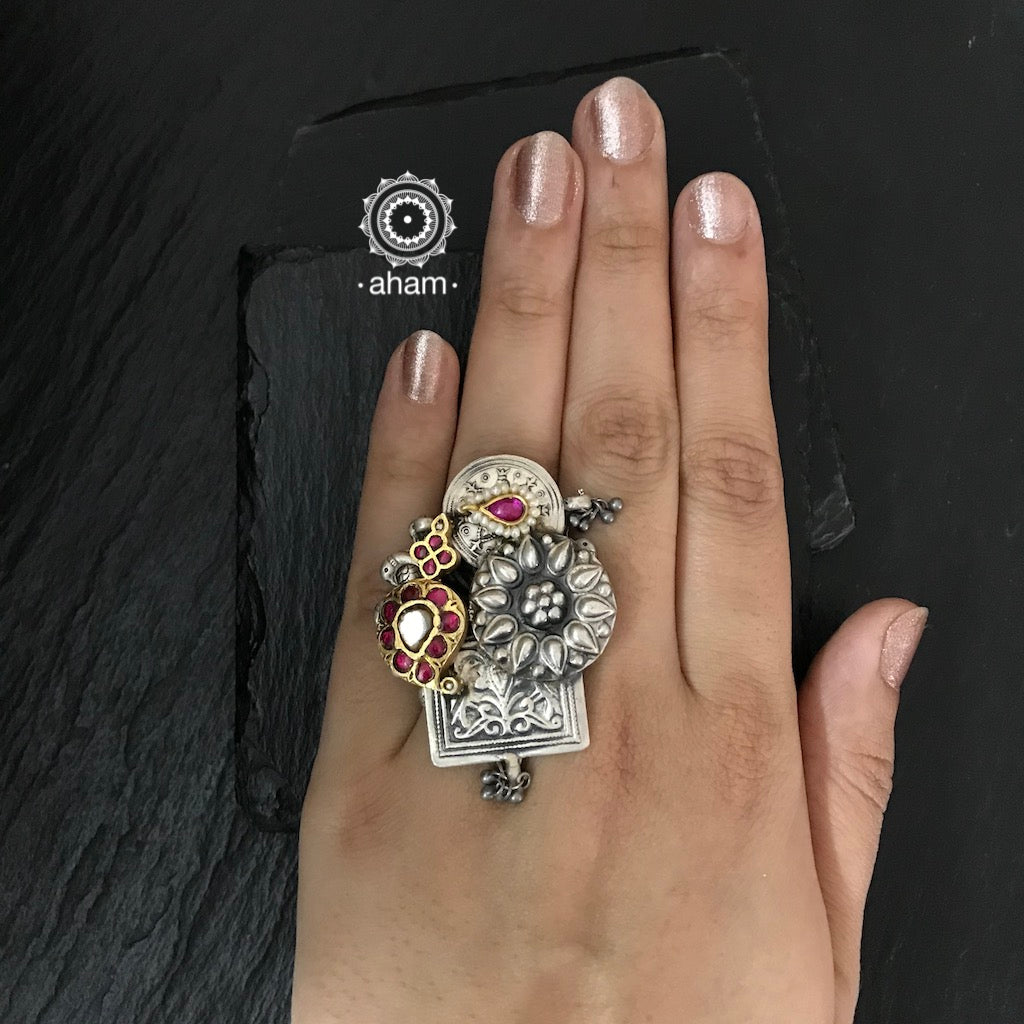 One of a kind statement wearable art pieces. Adjustable Ring in Sterling 92.5 silver with two tone gold polish work.