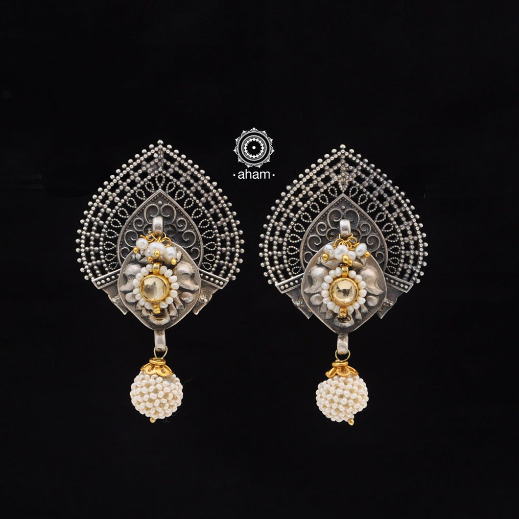 One of a kind statement wearable art pieces. Earrings in Sterling 92.5 silver with two tone gold kundan and Pearl