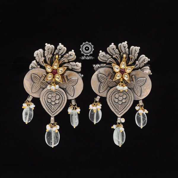 One of a kind statement wearable art pieces.  Earrings in Sterling 92.5 silver with two tone gold polish work.
