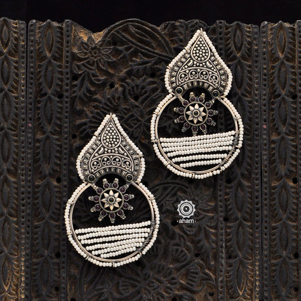 Handcrafted 92.5 sterling Silver earring from our Malhar collection.  hand silver work, with kemp stone highlights and laced with pearls