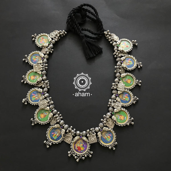 Hand Painted Krishna Neckpiece.  Multiple miniature Krishna pendants strung together with patri amulets, silver beads and ghunghroos