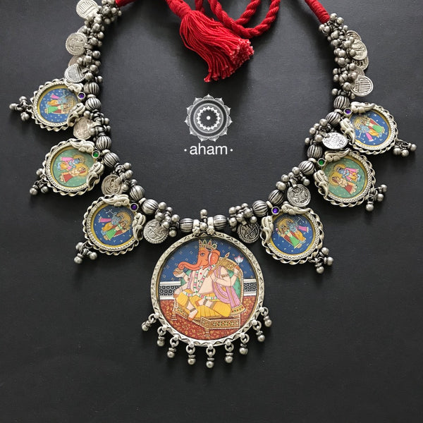 Hand Painted Ganesha and Krishna Neckpiece.  Multiple miniature Hand-painted pendants strung together with patri amulets, silver beads and ghunghroos