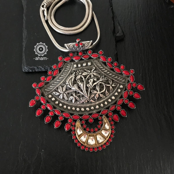 Silver 92.5 silver pendant with center Nakshi work, along with stone and kundan work.