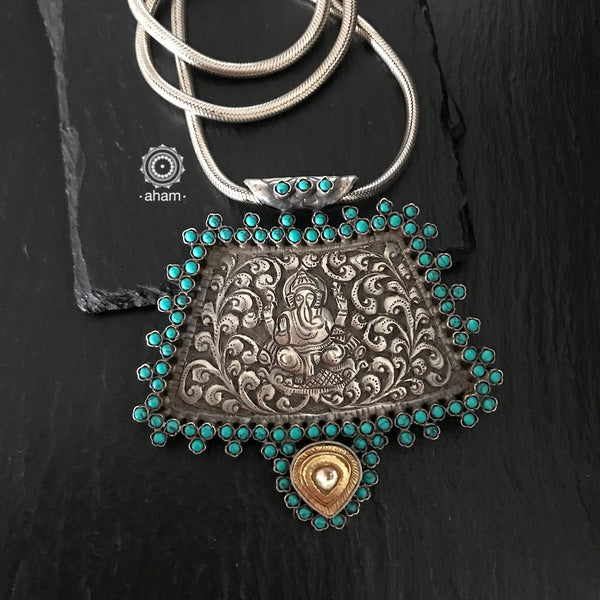 Silver 92.5 Ganesha pendant with center Nakshi work, along with stone and kundan work.