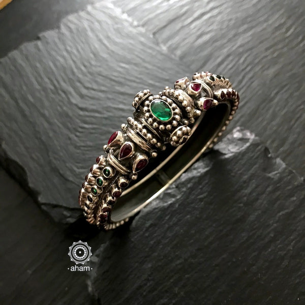 Handcrafted 92.5 Sterling Silver kada with kemp and green stones.  a versatile piece that works with most traditional Indian wear