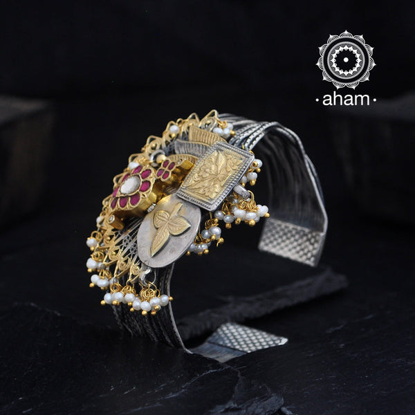 One of a kind statement wearable art pieces.  Silver hand kada with two tone gold polish kundan work.