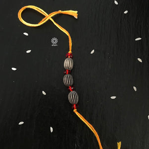 Silver and Red coloured bead Rakhi