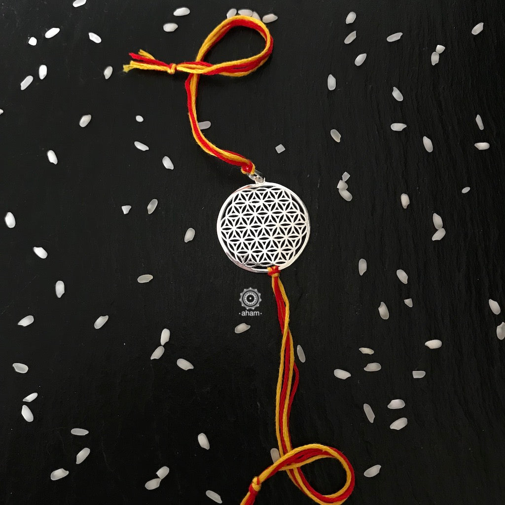 Beautiful Silver Rakhi  Make this Rakshabandhan Memorable with this handcrafted Rakhi   Silver dial weaved with cotton thread for an ever-lasting Knot.  The Dial comes with a loop so you can later use it as a pendant as well.