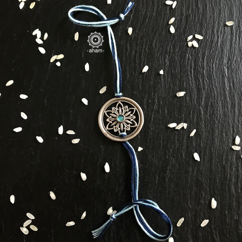 Beautiful Silver Rakhi, Make this Rakshabandhan Memorable with this handcrafted Rakhi  Silver dial weaved with cotton thread for an ever-lasting Knot.  Tip: you can later convert this into a key chain charm or a pendant as well
