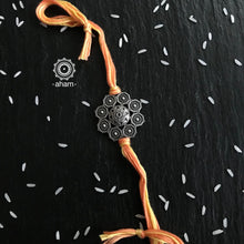 Beautiful Silver Rakhi, Make this Rakshabandhan Memorable with this handcrafted Rakhi  Silver dial weaved with cotton thread for an ever-lasting Knot.