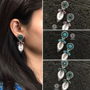 92.5 Sterling Silver Earrings with green and maroon coloured stones. Light weight and easy to wear. The grid image depicts the other colours in this design and model image for size reference.