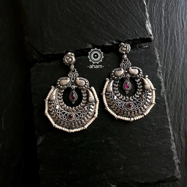 Make heads turn wherever you go with this pair of beautiful chandbalis handcrafted  in Sterling Silver (92.5) and laced with pearls