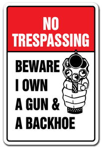 NO TRESPASSING BEWARE I OWN A GUN & BACKHOE Sign