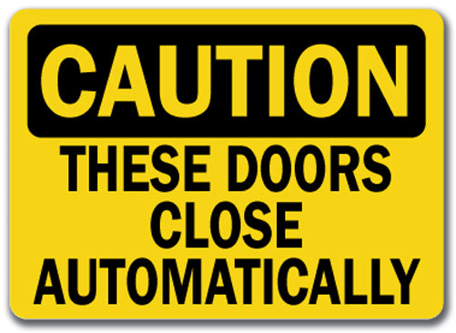 Caution Sign - These Doors Close Automatically
