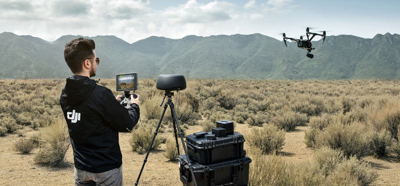 DJI Cendence held by a man using DJI Tracktenna to boost the DJI Inspire 2 signal