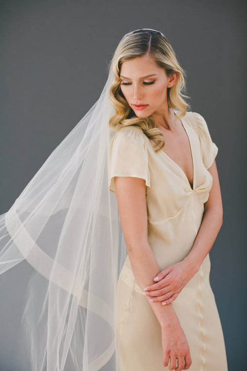 Champagne single-tier cathedral length ribbon edge bridal veil