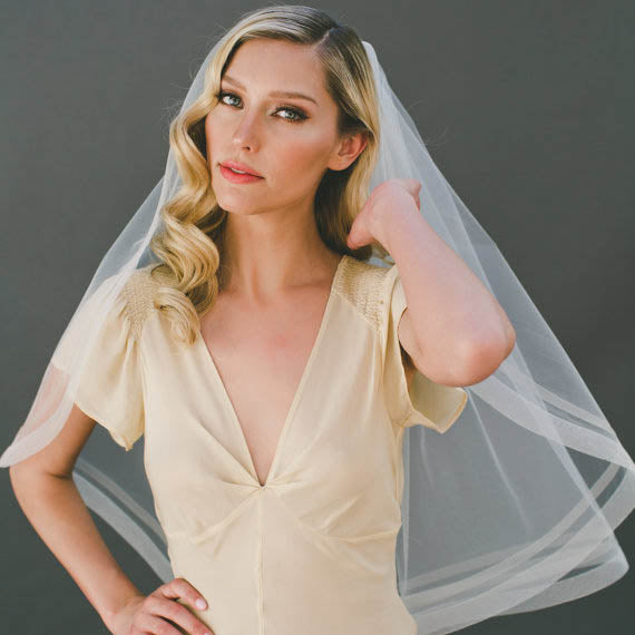 Champagne two-tier elbow length bridal veil with ribbon edge