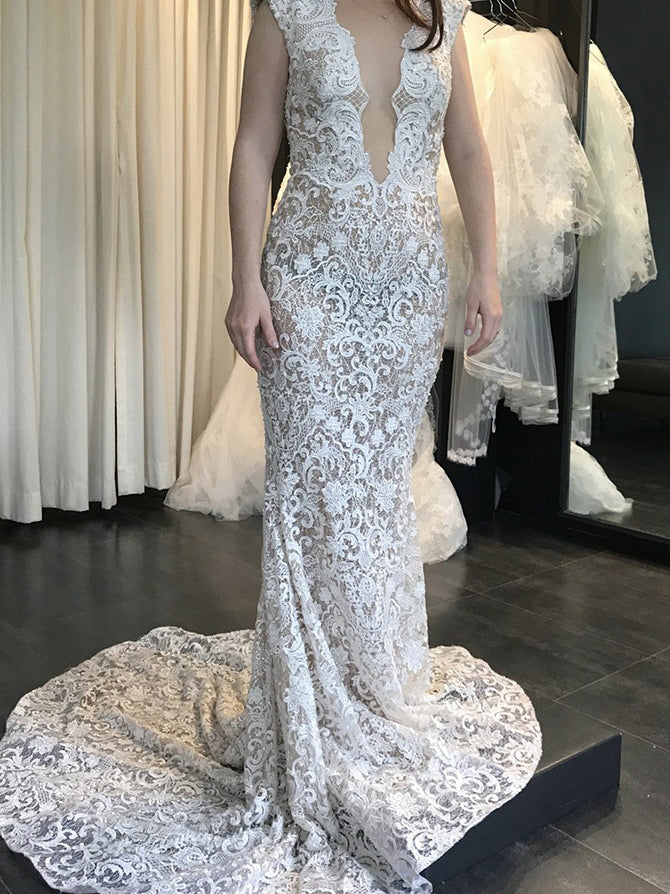 Deep v-neck backless appliqued mermaid wedding dress with sweep train