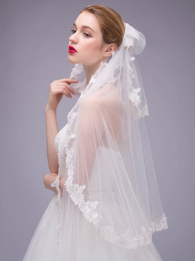 Functional three-tier lace edge elbow cathedral length veil