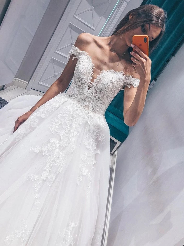 Off the shoulder appliqued ball gown wedding dress